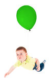 Child flying on a balloon Stock Images