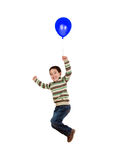 Child flying with blue balloon inflated Royalty Free Stock Images