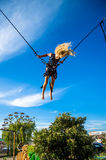 Child flying on bungee attraction Stock Photography