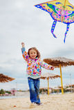 Child flying a kite Stock Photo