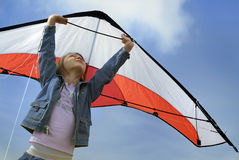 Child flying with a kite. Child playing with a kite stock image