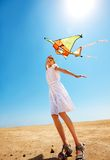 Kid flying kite outdoor. Royalty Free Stock Photo