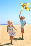 Kid flying kite outdoor. Royalty Free Stock Photos