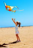 Kid flying kite outdoor. Stock Images