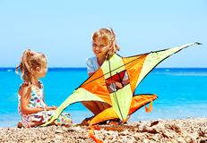 Kid flying kite outdoor. Royalty Free Stock Photography