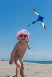 Child flying kite Royalty Free Stock Photos