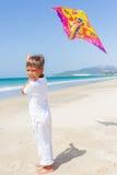 Child flying kite beach outdoor. Stock Photo