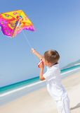 Child flying kite beach outdoor. Royalty Free Stock Photos