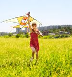 Child flying kite outdoor. Stock Photos