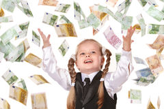 Child with flying money. Little girl in business suit with flying money. Isolated stock photography