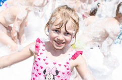 Child  and foam party Stock Photo