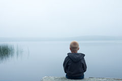 Child in foggy day Stock Photography