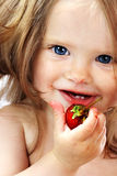 Child with food. Stock Image