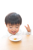 Child and food. The child who eats food Stock Photography