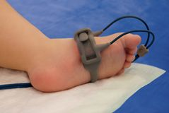 Child foot with oxymeter Stock Photo