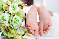 Child foot ready to spa treatment. Foot ready to spa treatment Stock Image