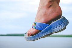 Child foot wearing flip-flops in air and landscape view Royalty Free Stock Photos