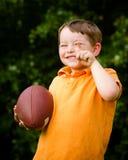 Child with football celebrating Stock Photo