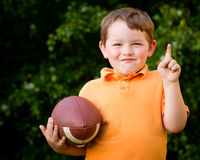 Child with football celebrating Royalty Free Stock Photography