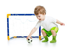 Child football player holding soccer ball Royalty Free Stock Photos