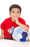 Child with a football toy Stock Images