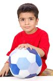 Child with a football toy Royalty Free Stock Photography