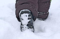 Child footing in snow Stock Photography