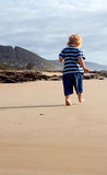 Child footsteps in sand Stock Photos