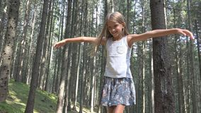 Child in Forest Walking on Log, Kid Playing Camping Adventure, Girl Outdoor Wood.  royalty free stock images