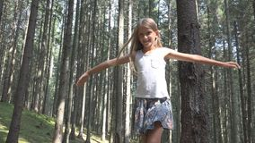 Child in Forest Walking on Log, Kid Playing Camping Adventure, Girl Outdoor Wood.  royalty free stock photo