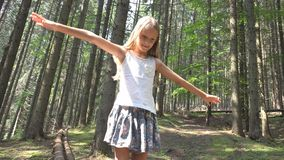 Child in Forest Walking on Log, Kid Playing Camping Adventure, Girl Outdoor Wood royalty free stock images
