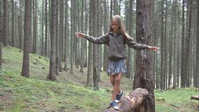 Child in Forest Walking Tree Log Kid Playing Camping Adventure Girl Outdoor Wood stock photo