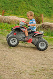 Child on four wheeler Royalty Free Stock Image