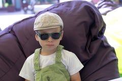 Child in frameless ottoman Royalty Free Stock Photo