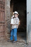 Child with fresh milk. Child exits form the byre with fresh milk just milking Stock Photo