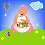 Child and fresh vegetable salad Stock Image