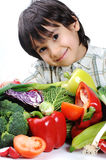 Child and fresh vegetables Royalty Free Stock Image