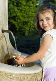 Child and fresh water Royalty Free Stock Images