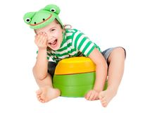 Child frog. A happy smiling child girl wearing green cap with eyes and mouth as frog isolated on white Royalty Free Stock Photo