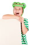 Child frog holding board Royalty Free Stock Photos
