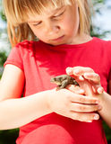 Child with frog Stock Photography