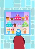 Child in front of a candy shop window. Child standing in front of a candy store and looking at the desserts Stock Photo