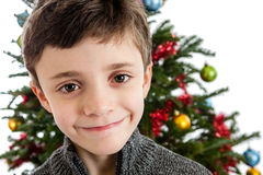Child in front of Christmas tree Royalty Free Stock Photos
