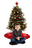 Child in front of Christmas tree Stock Images