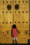 The child in front of the door Stock Images