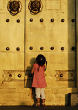 The child in front of the door. The little child would open the door Stock Images