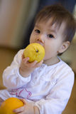 Child with fruit Royalty Free Stock Photography