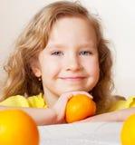 Child with fruit Stock Image