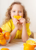 Child with fruit Stock Photography