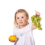 Child with fruits Royalty Free Stock Images